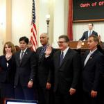 State Senator Bob Wieckowski takes the oath of office with several colleagues on the floor of the California State Senate.